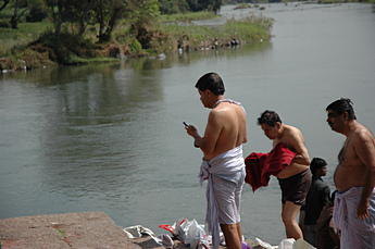 Holy bath in river with cell phone!